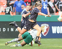 Allie Long #9 of the Washington Freedom leaps over Shannon Boxx #7 of St. Louis Athletica during a WPS match on May 1 2010, at RFK Stadium, in Washington D.C. Freedom won 3-1.