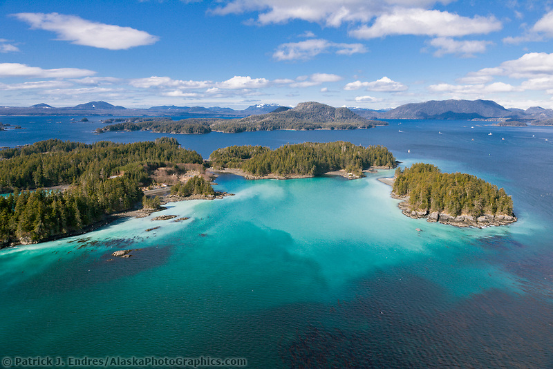 Islands in Sitka Sound, water infused with Herring spawn resulting in aqua blue colored water, Southeast, Alaska.