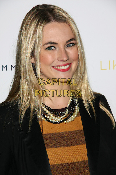 "Amanda Hearst .The New York Premiere of ""Like Crazy"" at the Landmark Sunshine Cinema, New York, NY, USA..October 18th, 2011.headshot portrait black yellow brown striped stripes top white pearl necklaces .CAP/LNC/TOM.©TOM/LNC/Capital Pictures."