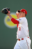 Starting pitcher Pat Light (32) of the Greenville Drive warms up prior to a game against the Kannapolis Intimidators on Friday, April 11, 2014, at Fluor Field at the West End in Greenville, South Carolina. Light was a supplemental pick (37th overall) by the Boston Red Sox in the 2013 First-Year Player Draft. (Tom Priddy/Four Seam Images)