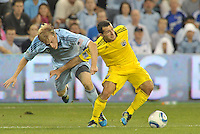 Columbus Crew midfielder Dilly Duka (11) holds off Sporting KC defender Seth Sinovic (16)... Sporting Kansas City defeat Columbus Crew 2-1 at LIVESTRONG Sporting Park, Kansas City, Kansas.