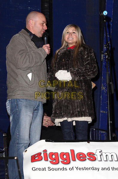 NIKKI GRAHAME .Big Brother 7's Nikki Grahame switches the Christmas Lights on in the Bedfordshire market town of Biggleswade, Bedfordshire, England, UK, December 4th 2009.xmas BB7 half length gloves brown fur coat smiling .CAP/JIL.©Jill Mayhew/Capital Pictures