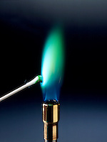 COPPER FLAME TEST: GREEN FLAME<br /> Wet Cotton Swab Dipped In Copper II Chloride<br /> Cupric chloride compound is dissociated by flame into gaseous atoms, not ions. Atoms of the element are raised to excited state by high temperature of flame. Excess energy from the atom is emitted as light of a characteristic wavelength.
