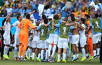 Uruguay celebrate their victory and progression to the next round of the World Cup