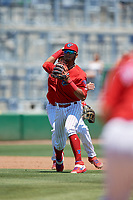 Clearwater Threshers shortstop Daniel Brito (21) throws to first base during a Florida State League game against the Florida Fire Frogs on April 24, 2019 at Spectrum Field in Clearwater, Florida.  Clearwater defeated Florida 13-1.  (Mike Janes/Four Seam Images)