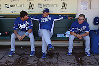 OAKLAND, CA - SEPTEMBER 5: Jeff Francoeur #21, manager Ned Yost #3, and coach Eddie Rodriguez #14 of the Kansas City Royals get ready in the dugout before the game against the Oakland Athletics at O.co Coliseum on September 5, 2011 in Oakland, California. Photo by Brad Mangin