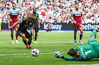 Sergio Aguero of Manchester City sees his penalty saved by Lukasz Fabianski of West Ham United only for VAR to determine it should be retaken during the Premier League match between West Ham United and Manchester City at the London Stadium, London, England on 10 August 2019. Photo by David Horn.