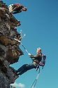 Dr Wyn Jones abseiling into canyon, Dave Noble on top, Wollemi National Park, New South Wales