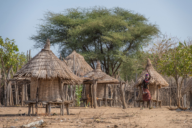 This Karo settlement is set on a sand cliff overlooking a large sweep in the Omo River and contains around 30 simple thatch huts.