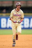 Drew Mendoza (22) of the Florida State Seminoles celebrates as he rounds the bases after hitting a 3-run home run against the North Carolina Tar Heels during the 2017 ACC Baseball Championship Game at Louisville Slugger Field on May 28, 2017 in Louisville, Kentucky.  The Seminoles defeated the Tar Heels 7-3.  (Brian Westerholt/Four Seam Images)