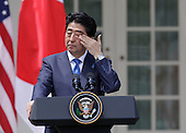 US President Barack Obama and Japan's Prime Minister Shinzo Abe participate in a joint press conference at The White House in Washington DC for a State Visit, April 28, 2015. Credit: Chris Kleponis / CNP