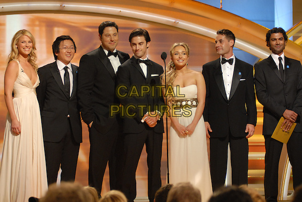 "ALI LARTER, GREG GRUNBERG, ADIRAN PASDAR, HAYDEN PANETTIERE, SENDHIL RAMAMURTHY, MASI OKA & MILO VENTIMIGLIA.The cast of ""Heroes"" present Actor in a Leading Role - Drama Series.Telecast - 64th Annual Golden Globe Awards, Beverly Hills HIlton, Beverly Hills, California, USA..January 15th 2007. .globes full length microphone stage.CAP/AW.Please use accompanying story.Supplied by Capital Pictures.© HFPA"" and ""64th Golden Globe Awards"""