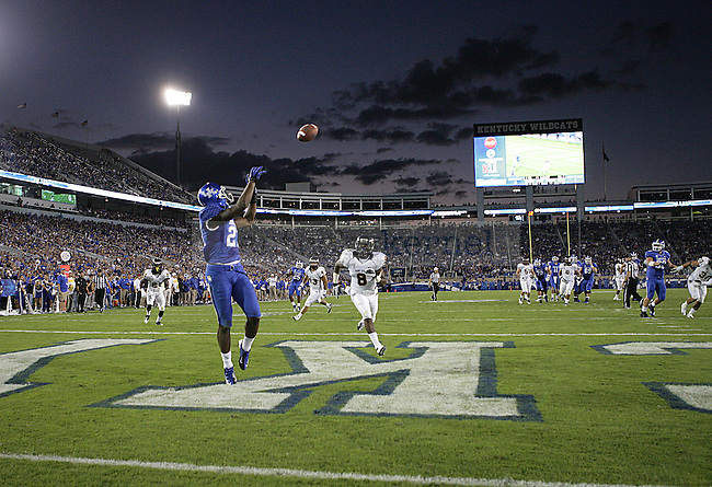 Senior wide receiver Aaron Boyd catches the ball for a touchdown against Kent State at Commonwealth Stadium on Saturday, Sept. 8, 2012. Photo by Scott Hannigan | Staff