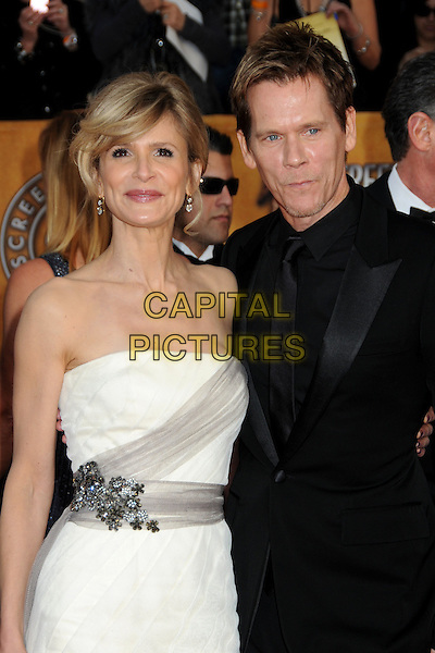 KYRA SEDGWICK & KEVIN BACON.16th Annual Screen Actors Guild Awards - Arrivals held at The Shrine Auditorium,  Los Angeles, California, USA, .23rd January 2010..SAG SAGs half length strapless white dress black suit tie married couple husband wife beaded grey gray silk waistband .CAP/ADM/BP.©Byron Purvis/Admedia/Capital Pictures