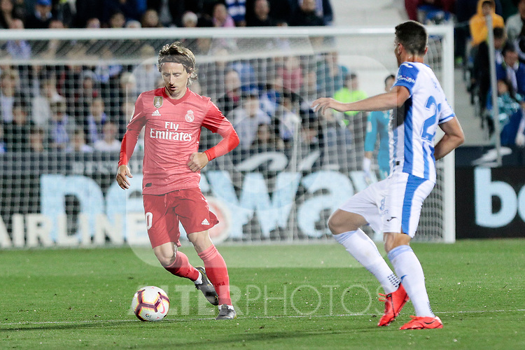 CD Leganes's Ruben Perez and Real Madrid's Luka Modric during La Liga match between CD Leganes and Real Madrid at Butarque Stadium in Leganes, Spain. April 15, 2019. (ALTERPHOTOS/A. Perez Meca)