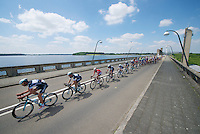 Team OmegaPharma-QuickStep leads the way over the wier next to the lake<br /> <br /> 2014 Belgium Tour<br /> stage 4: Lacs de l'Eau d'Heure - Lacs de l'Eau d'Heure (178km)
