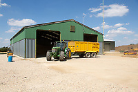 Tractor and trailer taking Winter barley into a grain store<br /> &copy;Tim Scrivener Photographer 07850 303986<br />      ....Covering Agriculture In The UK....