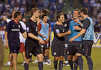 Steve Cherundalo and Jimmy Conrad celebrate after the USA clinches a spot in the  2010 World Cup after defeating Honduras in 3-1 during CONCACAF qualifying in San Pedro Sula, Honduras, October 10, 2009.