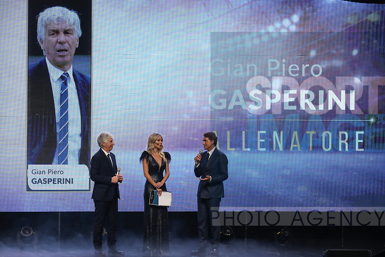 Gian Piero Gasperini Head coach of the Year 2019 pictured with Diletta Leotta and Roberto Mancini at the The Italian Footballers Association Grand Gala of Football at the Megawatt Court, Milan. Picture date: 2nd December 2019. Picture credit should read: Jonathan Moscrop/Sportimage