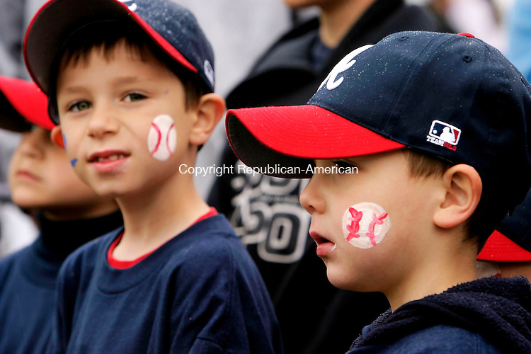 WOLCOTT, CT- 30 APRIL 2005-043005JS01--Aaron Belanger, 6, left and Colin Pawlak, 5, right, listen to speakers during opening ceremonies for the Baseball Association of Wolcott 2005 season Saturday at the BAW baseball complex in Wolcott. The two play for the D-League Braves.   --- Jim Shannon Photo-- are CQ