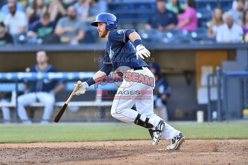 Asheville Tourists first baseman Brian Mundell (15) swings at a pitch during a game against the Hagerstown Suns at McCormick Field on April 28, 2016 in Asheville, North Carolina. The Tourists were leading the Suns 6-5 when the game was delayed in the top of the 6th inning due to darkness. (Tony Farlow/Four Seam Images)