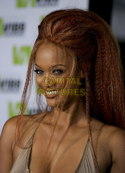 TYRA BANKS.Attends The 2nd Annual Vibe Awards which will be aired on UPN. The event was taped at Barkar Hangar in Santa Monica, California,USA, November 15th 2004..portrait headshot .Ref: DVS.www.capitalpictures.com.sales@capitalpictures.com.©Debbie VanStory/Capital Pictures .