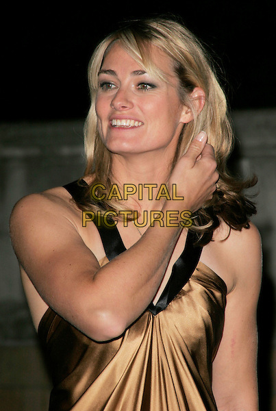 SARAH WEBBE .attends the Olympic Gold Ball at the Natural History Museum, London, England, October 8th 2008..portrait headshot gold dress silk satin cross necklace hand touching hair arm .CAP/AH.©Adam Houghton/Capital Pictures