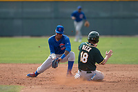 Chicago Cubs second baseman Yeiler Peguero (15) prepares to apply the tag to Austin Beck (18) during a Minor League Spring Training game against the Oakland Athletics at Sloan Park on March 13, 2018 in Mesa, Arizona. (Zachary Lucy/Four Seam Images)