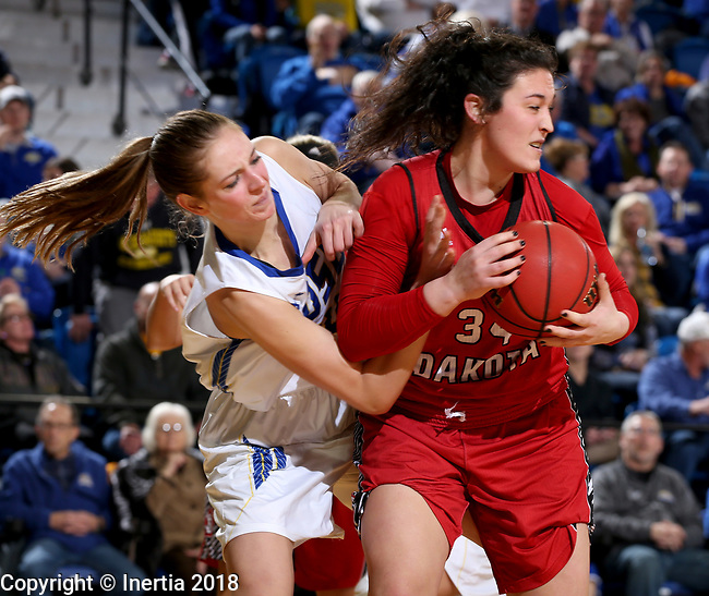 BROOKINGS, SD - JANUARY 25: Tagyn Larson #24 from South Dakota State University reaches in against Kate Liveringhouse #34 from the University of South Dakota during their game Thursday night at Frost Arena in Brookings. (Photo by Dave Eggen/Inertia)
