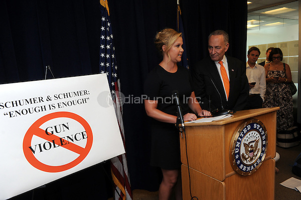 Senator Chuck Schumer and comedian Amy Schumer hold a press conference announcing plans to crackdown on mass shootings and gun violence on August 03, 2015 in New York. Credit: Dennis Van Tine/MediaPunch