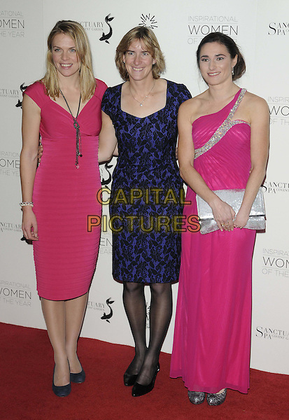 Anna Watkins, Katherine Grainger & Sarah Storey.The 2012 Daily Mail Inspirational Women of the Year Awards, London Marriott Grosvenor Square Hotel, Grosvenor Square, London, England..November 12th, 2012.full length pink purple lace black one shoulder silver clutch bag dress.CAP/CAN.©Can Nguyen/Capital Pictures.