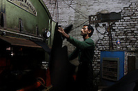 A worker in a small and informal leather-producing tannery in Kanpur.