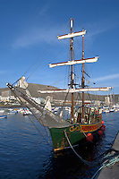 Sailing boat moored at jetty, Los Cristianos harbour, Tenerife, Canary Islands.