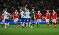 Tempers flare after Vladimir Stojkovic of Serbia races from his goal to argue a decision and is shown a yellow card during the FIFA World Cup Qualifying match between Wales and Serbia at the Cardiff City Stadium, Cardiff, Wales on 12 November 2016. Photo by Mark  Hawkins.