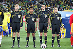15 JUN 2010:  Referee lineup: (l-r)  Assistant Referee Tibor Vamos (HUN), Fourth Official Subkhiddin Mohd Sallem (MAS), Referee Viktor Kassai (HUN), Assistant Referee Gabor Eros (HUN).  The Brazil National Team played the North Korea National Team to a 0-0 tie at the end of the 1st half at Ellis Park Stadium in Johannesburg, South Africa in a 2010 FIFA World Cup Group G match.