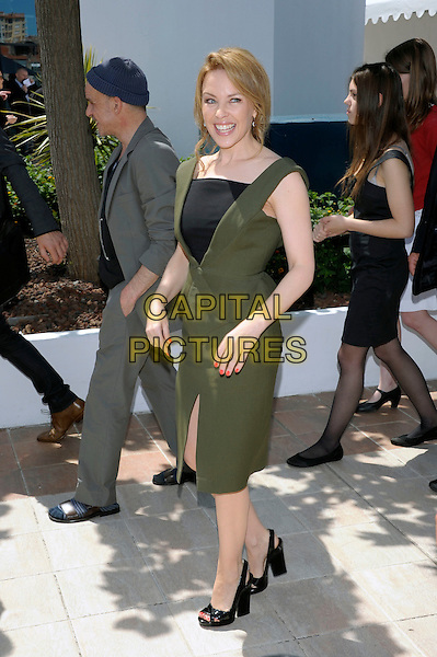 Kylie Minogue.'Holy Motors' photocall at the 65th  Cannes Film Festival, France..23rd May 2012.full length green peplum dress black sleeveless slit split  .CAP/PL.©Phil Loftus/Capital Pictures.