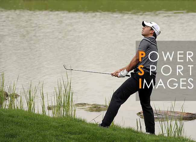 SUZHOU, CHINA - APRIL 18:  Pablo Larrazabal of Spain chips into the 6th green during the Round Four of the Volvo China Open on April 18, 2010 in Suzhou, China. Photo by Victor Fraile / The Power of Sport Images