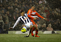 Pictured: Gylfi Sigurdsson of Swansea (R) challenged by Paul Scharner  (L) of West Bromwich. Saturday, 04 February 2012<br />