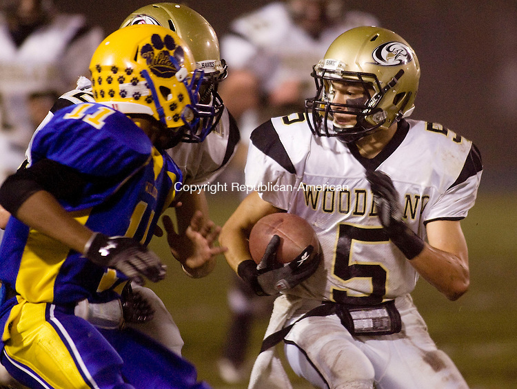 SEYMOUR, CT - 25 NOVEMBER 2009 -112509JT09--<br /> Woodland's Brandon Fowler runs behind his teammate Tyler Slapikas as Fowler avoids Seymour's Donnel Lewis during Wednesday's game at Seymour. The Hawks won, 55-32.<br /> Josalee Thrift Republican-American