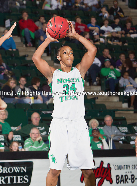 North Texas Mean Green guard Tamara Torru (34) in action during the game between the Louisiana Lafayette Ragin' Cajuns and the University of North Texas Mean Green at the North Texas Coliseum,the Super Pit, in Denton, Texas. UNT defeats Louisiana Lafayette 78 to 40....
