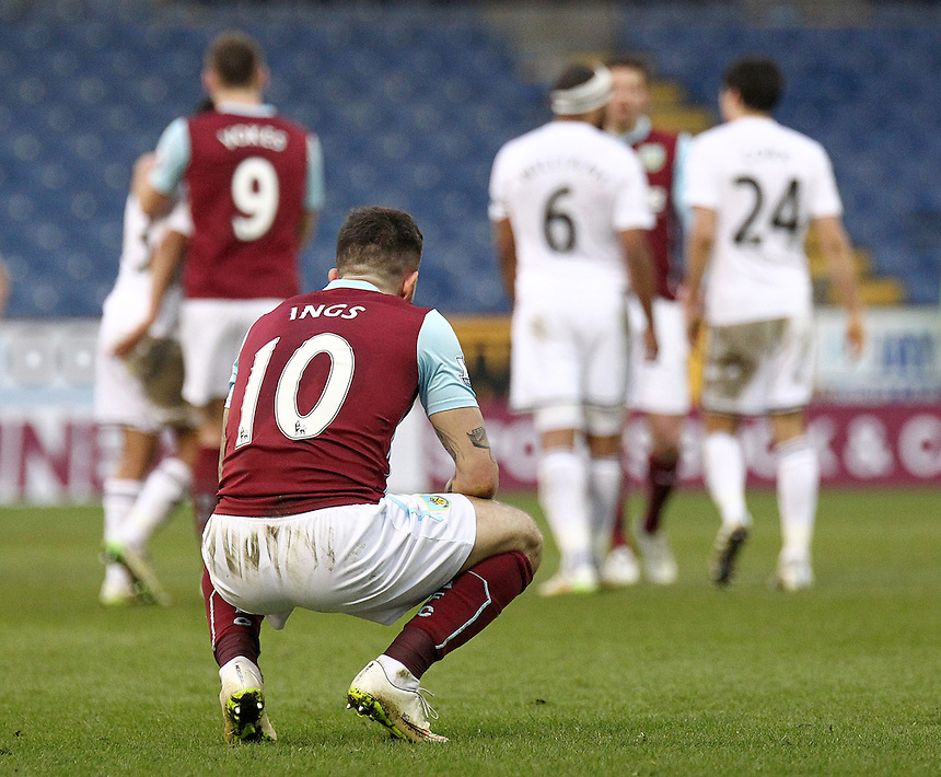 Burnley's Danny Ings is dejected at the final whistle as Burnley slip to a narrow defeat<br /> <br /> Photographer Rich Linley/CameraSport<br /> <br /> Football - Barclays Premiership - Burnley v Swansea City - Friday 27th February 2015 - Turf Moor - Burnley<br /> <br /> &copy; CameraSport - 43 Linden Ave. Countesthorpe. Leicester. England. LE8 5PG - Tel: +44 (0) 116 277 4147 - admin@camerasport.com - www.camerasport.com