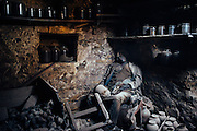 A woman killed in the basement of a house in Logvinova, about 80 kilometers (50 miles) from the center of Donetsk. 24 February 2015