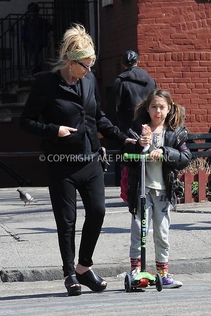 WWW.ACEPIXS.COM . . . . . .April 15, 2013...New York City....Deborra-Lee Furness and Ava Jackman take a walk in the West Village on April 15, 2013 in New York City ....Please byline: KRISTIN CALLAHAN - WWW.ACEPIXS.COM.. . . . . . ..Ace Pictures, Inc: ..tel: (212) 243 8787 or (646) 769 0430..e-mail: info@acepixs.com..web: http://www.acepixs.com .