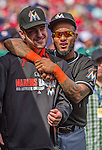 28 September 2014: Miami Marlins second baseman Jordany Valdespin (right) clowns around in the dugout prior to facing the Washington Nationals for the last game of the regular season at Nationals Park in Washington, DC. The Nationals shut out the Marlins with a 1-0 no-hitter going to Nationals pitcher Jordan Zimmermann. Mandatory Credit: Ed Wolfstein Photo *** RAW (NEF) Image File Available ***