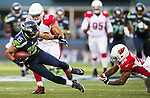 Seattle Seahawks  wide receiver Jermaine Kearse (15) is tripped up after catching a 19-yard pass by Arizona Cardinals safety Rashad Johnson (26) at CenturyLink Field in Seattle, Washington on November 23, 2014. The Seahawks beat the Cardinals 19-3.     ©2014. Jim Bryant Photo. All Rights Reserved.