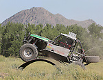 Ryan Stulc #187 rolls over an obstacle at the beginning of the Buffalo Chip 100 off-road racing event Saturday at the T.O.R.C. track in Sturgis, S.D. (Photo by Richard Carlson/Inertia)