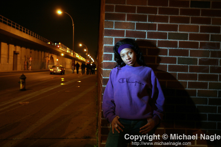 QUEENS, NY - APRIL 22, 2008:  Lil Mama stands on the corner of 144th Place and Archer Avenue after her show at the Amazura Night Club was cancelled on April 22, 2008 in Jamaica, Queens.   (Photograph by Michael Nagle)