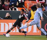 D.C. United midfielder Andy Najar (14) goes against Sporting Kansas City defender Seth Sinovic (16) Sporting Kansas City defeated D.C. United  1-0 at RFK Stadium, Saturday March 10, 2012.