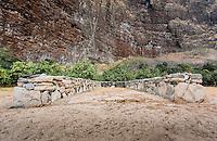 Hawaiian stone wall canoe shelter in Nualolo Kai village, Na Pali coast, Kauai