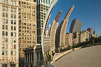 "Buildings alongside of Michigan Avenue reflecting in The Bean (aka Cloud Gate) at Millenium Park. The architecture of Chicago has influenced and reflected the history of American architecture. The city of Chicago, Illinois features prominent buildings in a variety of styles by many important architects. Since most buildings within the downtown area were destroyed by the Great Chicago Fire in 1871, Chicago buildings are noted for their originality rather than their antiquity..Beginning in the early 1880s, architectural pioneers of the Chicago School explored steel-frame construction and, in the 1890s, the use of large areas of plate glass. These were among the first modern skyscrapers and amongst their most famous architects were William LeBaron, John Wellborn Root Sr., Daniel Burnham and Charles Atwood. Louis Sullivan was perhaps the city's most philosophical architect. Realizing that the skyscraper represented a new form of architecture, he discarded historical precedent and designed buildings that emphasized their vertical nature. This new form of architecture, by Jenney, Burnham, Sullivan, and others, became known as the ""Commercial Style,"" but it was called the ""Chicago School"" by later historians..Since 1963, a ""Second Chicago School"" emerged, largely due to the ideas of structural engineer Fazlur Khan. Some of Chicago's skyscrapers such as the John Hancock Center, Willis Tower (formerly known as the Sears Tower) and The Trump International Hotel and Tower are amongst the tallest buildings in the world."